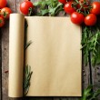 Open recipe book with fresh herbs, tomatoes and spices on wooden background — Stock Photo #70236087