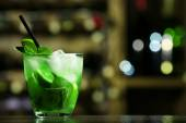 Glass of cocktail on bar background — Stock Photo