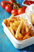 Tasty burger and french fries on wooden table background  Unhealthy food concept — Stock Photo