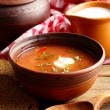 Ukrainian beetroot soup - borscht in bowl and pot, on napkin, on wooden background — Stock Photo #70600017