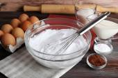 Whipped egg whites for cream and other ingredients on wooden table, closeup — Stock Photo