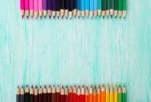 Colorful pencils on wooden table — Stock Photo