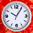 Food clock with tomato as background. Healthy food concept — Stock Photo #70791719