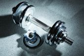 Dumbbell on gray background — Stock Photo