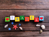 Travel inscription on wooden background — Stok fotoğraf