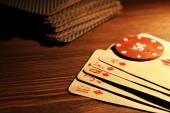 Playing cards with chips — Stock Photo