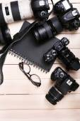 Modern cameras on wooden table — Stock Photo