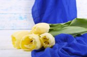 Beautiful bouquet of yellow tulips on wooden background — Stock Photo