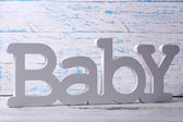 Word baby on wooden background — Stockfoto