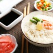 Boiled rice with shrimps and vegetables on bamboo mat background — Stock Photo #71129205