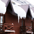 Wooden building with icicles on roof, outdoors — Stock Photo #71132517