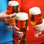 Beer in female hands, closeup — Stock Photo #71138999