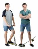 Two handsome young men with skate and scooter isolated on white — Stock Photo