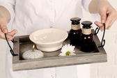 Beauty therapist holding tray of spa treatments, close-up — Стоковое фото
