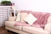 Modern room with comfortable sofa, indoors — Stock Photo