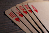 Playing cards on wooden table, closeup — Stock Photo