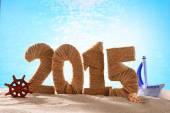 2015 sign on beach sand — Stock Photo