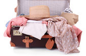 Packing suitcase for trip isolated on white — Stock Photo
