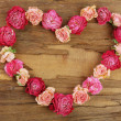 Heart of beautiful dry flowers on wooden background — Stock Photo #71141887
