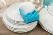 Dishes in foam with wisp on table close up — Stock Photo