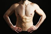 Muscle young man on black background — Stock Photo