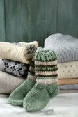 Knitting clothes on wooden background — Photo