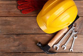 Construction tools with helmet on table close up — Stock Photo
