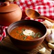 Ukrainian beetroot soup - borscht in bowl and pot, on napkin, on wooden background — Stock Photo #71221927