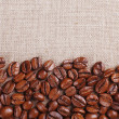 Frame of coffee beans on color sackcloth background — Stock Photo #71224897