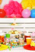 Prepared birthday table with sweets for children party — 图库照片