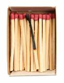 Burnt match in matchbox isolated on white — Stock Photo