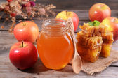 Delicious honey with apple on table close-up — Stock Photo
