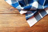 Napkin on wooden background — Stock Photo