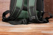 Backpack on wooden background — Stock Photo