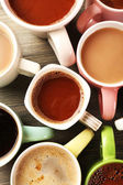 Many cups of coffee on wooden table, top view — Stock Photo