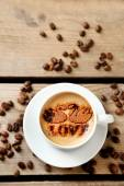 Cup of coffee on old wooden table — Stock Photo