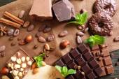 Chocolate with mint, spices and coffee beans on table, closeup — Stock Photo