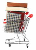 Shopping cart with books isolated on white — Stock Photo