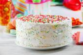 Birthday cake on colorful background — Stock Photo