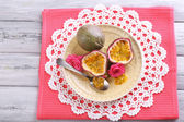 Passion fruit on plate on color wooden background — Stock Photo