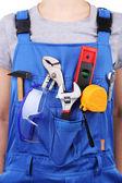 Man in overall met tools — Stockfoto