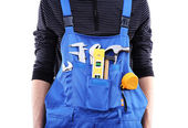 Man in coveralls with tools — Stock Photo