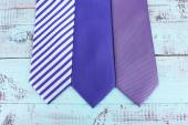 Various of ties on wooden background — Stock Photo