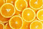 Pomarańczowy tło w plasterkach — Zdjęcie stockowe