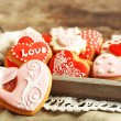 Heart shaped cookies for valentines day on tray, on wooden background — Stock Photo #71285943