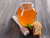 Delicious honey with honeycomb on table close-up — Stock Photo