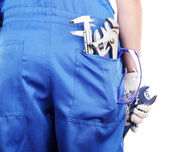 Man in coveralls with tools i — Stockfoto