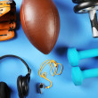 Sports equipment on color table, top view — Stock Photo #71374965
