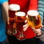 Beer in female hands, closeup — Stock Photo #71375387