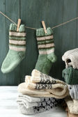 Knitting clothes on wooden background — Stock Photo